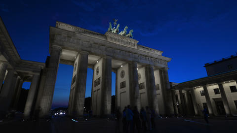 Time lapse of tourists visiting Brandenburg Gate in Berlin. Dusk till night Footage