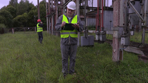 Electricians take instruction before launch work Footage