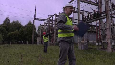 Electrician talking in substation Live Action