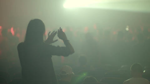 Young woman dancing on a concert Footage