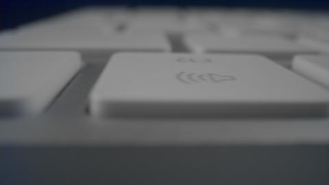 White buttons on computer keyboard in detail. Modern white keyboard on table Live Action