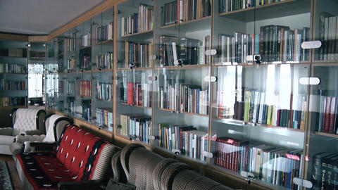 a library with books in the living room GIF