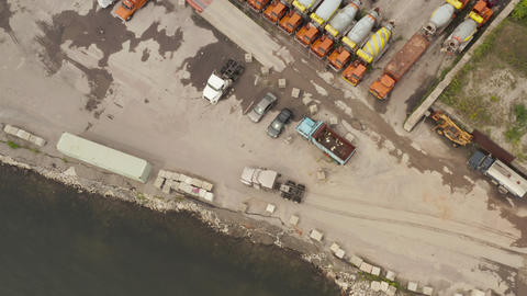 AERIAL: Following grey Cargo truck in docks of New York City Cloudy Grey day Live Action