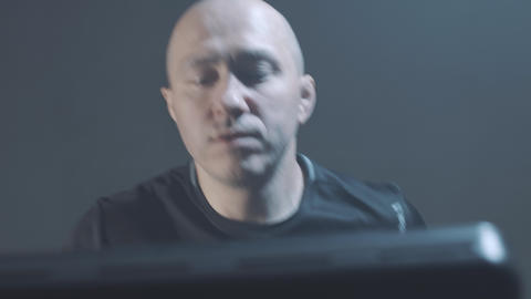 Close-up portrait of bald Caucasian man running in gym. Confident adult guy Live Action