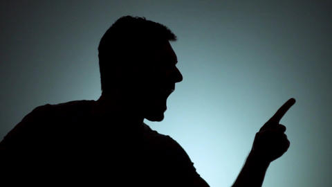 A man in a rage, a man angry, pointing with his index finger. Emotions, negative Live Action