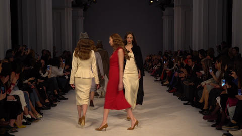 Fashion show. Group of models walking on the catwalk. Slow motion Live Action