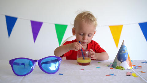 Caucasian child drink juice. Birthday afterparty. Gimbal movement forward Live Action