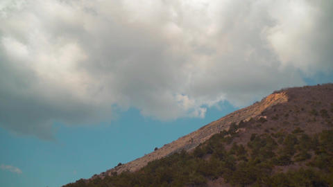 The movement of clouds high in the mountains, beautiful mountains, a mountain Live Action