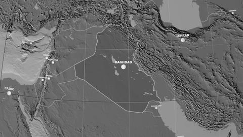 Zoom-in on Iraq outlined. Grayscale contrasted Animation