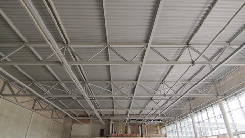 Ceiling of metal construction of a large modern room. Panorama of iron modern Live Action