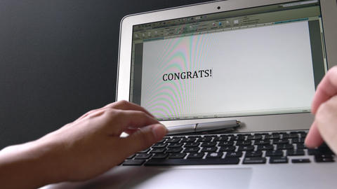 Businesswoman typing Congrats you got the job on the keyboard and the words appear on computer Live Action