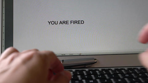 Businesswoman typing the words, You are fired Live Action