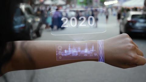 Female hand activates hologram 2020 Live Action