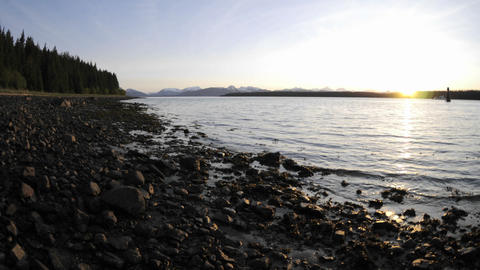 Time lapse motion of the tide retreating on the beach in Glacier Bay National Park in Gustavus, Alas Footage