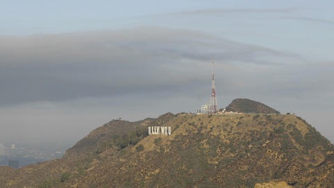 Time lapse motion of clouds blowing over the Hollywood... Stock Video Footage