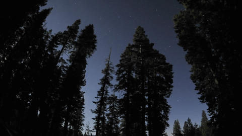 Time lapse of star trails, clouds and full moon rising... Stock Video Footage