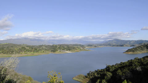 Time lapse motion of clouds and sunset over Lake Casitas... Stock Video Footage