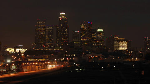 Time lapse motion of cars and train commuting into Los Angeles at dawn, California Footage