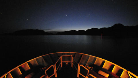 Point of view time lapse of a ship leaving Sitka at night and cruising up Olga Strait in Southeast Footage