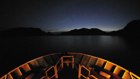 Point of view time lapse of a ship leaving Sitka at night... Stock Video Footage
