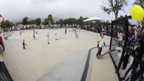 Time lapse of skateboarders at the grand opening of Ojai Skate Park in Ojai, California Footage