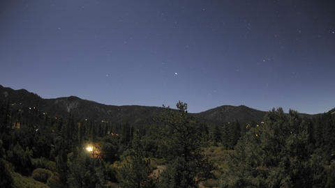 Time lapse of startrails and full moon setting over Pine Mountain Club, California Footage