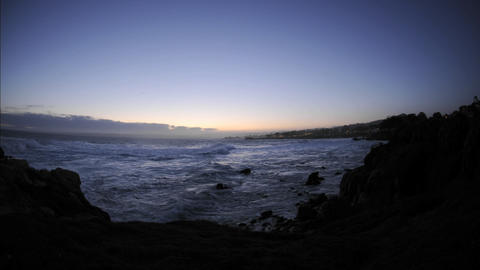 Time lapse of waves before sunrise over Pacific Grove... Stock Video Footage