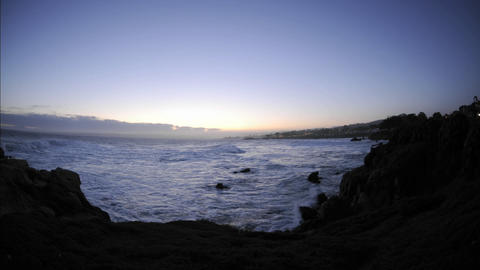 Time lapse of waves before sunrise over Pacific Grove Marine Garden Park in Pacific Grove, Californi Footage