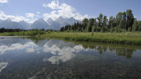 Time lapse of clouds at Schwabacher Landing in Grand Teton National Park, Wyoming Footage