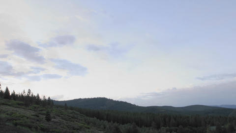 Day to night time lapse of clouds and stairtrails in Tahoe National Forest in Truckee, California Footage