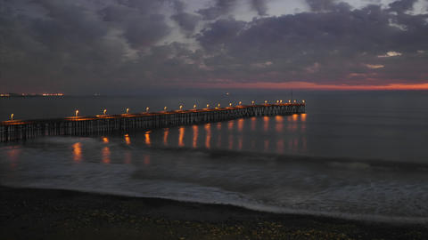 Night time lapse of clouds and waves at the historic San Buenaventura Pier in Ventura, California Footage