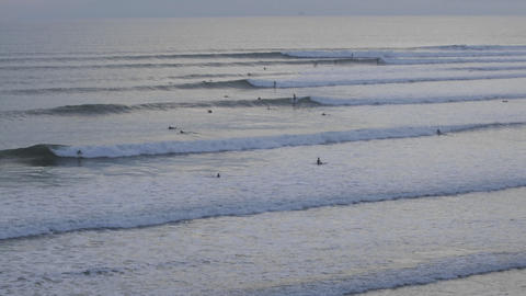 Time lapse of surfers catching set waves at Ventura Point... Stock Video Footage
