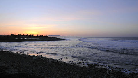 Waves breaking at sunrise at Surfers Point from Emma... Stock Video Footage