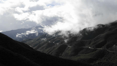 Time lapse of fast storm clouds clearing over the Santa Ynez Mountains above Ojai, California Footage