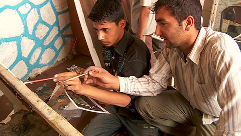 Two boys work on a painting at an art school in Kabul,... Stock Video Footage