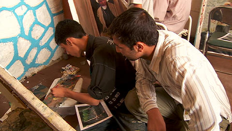 Two boys work on a painting at an art school in Kabul, Afghanistan Footage