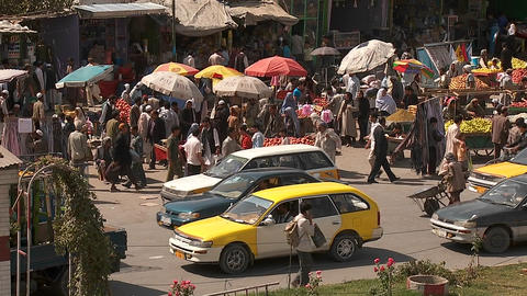 Taxis and vehicle traffic near a busy fruit market in... Stock Video Footage