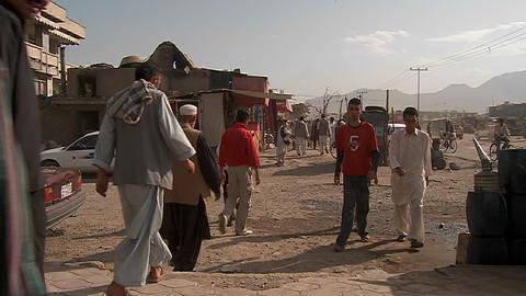 Slow mo shot of people walking on dirt streets of Kabul, Afghanistan Footage