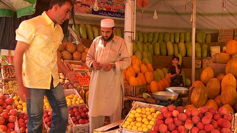 A man shops in a fruit market in Kabul, Afghanistan Stock Video Footage