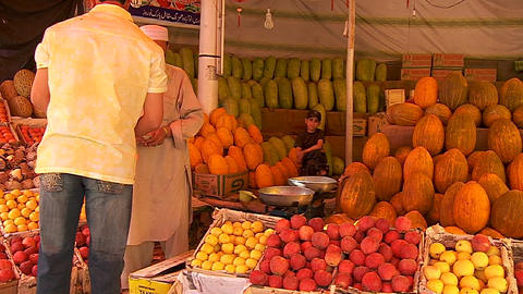 A man shops in a fruit market in Kabul, Afghanistan Footage