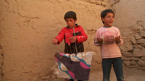 A blind child and friend play with broken kites in Kabul,... Stock Video Footage