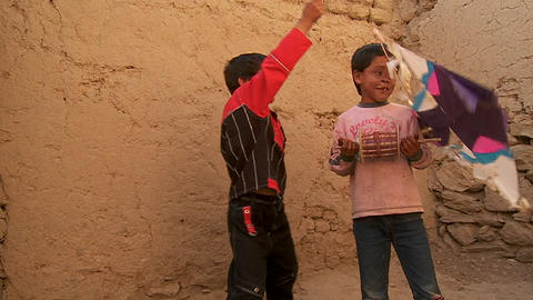 A blind child and friend play with broken kites in Kabul, Afghanistan Footage