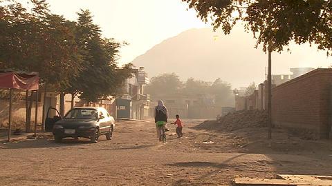 Pedestrians in a neighborhood in Kabul, Afghanistan Stock Video Footage
