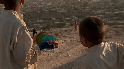 Kids fly kites on a giant spool on a hill overlooking... Stock Video Footage