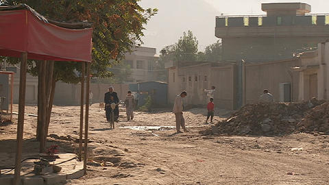 Pedestrians on street in Kabul, Afghanistan Stock Video Footage
