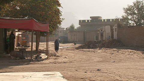 Woman in burqa walks down a street in Kabul, Afghanistan Stock Video Footage