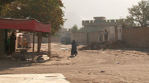 Woman in burqa walks down a street in Kabul, Afghanistan Footage