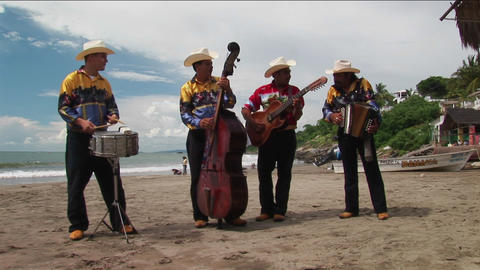 A mariachi band plays on a beach Stock Video Footage
