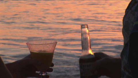 A couple makes a toast to the ocean Stock Video Footage