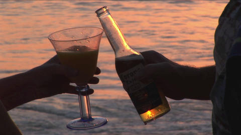 A couple makes a toast to the ocean Footage
